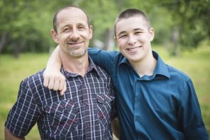 teen boy with father